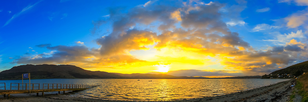 Panoramic view of sunset over Carlingford Lough viewed from Killowen Point towards The Cooley Mountains