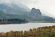 Beacon Rock, Columbia River Gorge National Scenic Area, Washington (seen from the Oregon side of the river), USA. Beacon Rock is a striking monolith composed of basalt, 848 feet high (258 meters). In 1805, Lewis and Clark originally referred to it as Beaten Rock, later as Beacon Rock. They found that Beacon Rock marked the eastern-most tidal influence in the Columbia. It was later known as Castle Rock until 1915 when its name changed back to Beacon Rock.