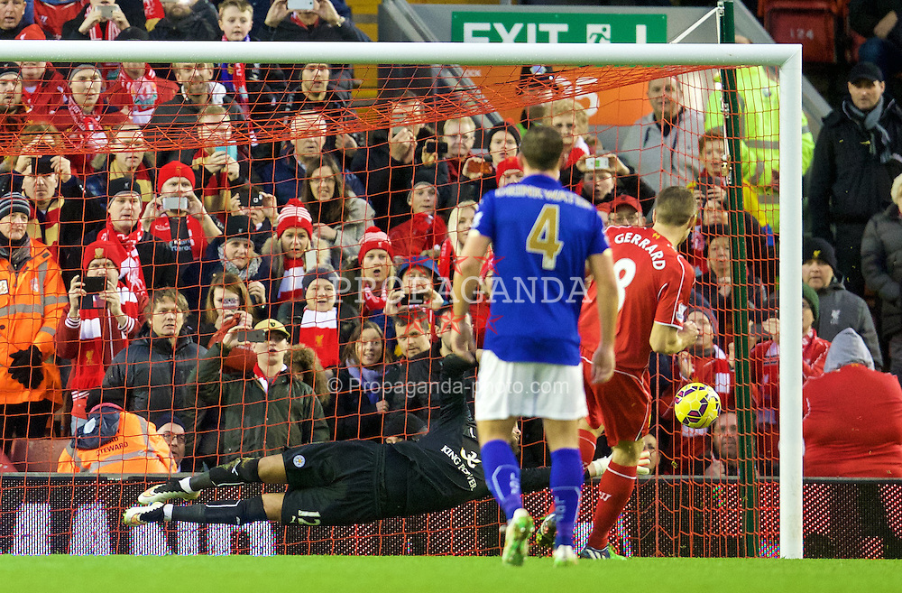 LIVERPOOL, ENGLAND - Thursday, New Year's Day, January 1, 2015: Liverpool's captain Steven Gerrard scores the first goal against Leicester City's goalkeeper Ben Hamer from the penalty spot during the Premier League match at Anfield. (Pic by David Rawcliffe/Propaganda)