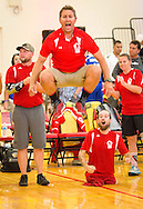 Marine volleyball coach Brent Petersen reacts his team comes within one point of winning match during sitting volleyball round-robin tournament game between team Marine and Team Army during the 2015 Department of Defense Warrior Games on Thursday June 25, 2015 aboard Marine Corps Base Quantico. Team Marine won this match. (Alan Lessig/Staff)