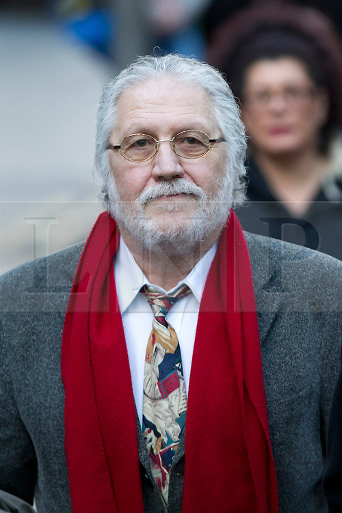 © Licensed to London News Pictures. 13/01/2014. London, UK. Former Radio One presenter Dave Lee Travis, real name David Patrick Griffin, arrives at Southwark Crown Court in London today (13/01/2014). Travis is appearing in court, after being arrested at his home by the Metropolitan Police as part of Operation Yewtree, due to alleged sexual assaults during the 1970's and 80's during his time at the BBC  Photo credit: Matt Cetti-Roberts/LNP