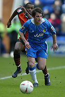 Photo: Chris Brunskill. Wigan Athletic v Ipswich Town. Coca-Cola Championship. 05/03/2005. Leighton Baines of WIgan is pursued by Darren Bent of Ipswich.