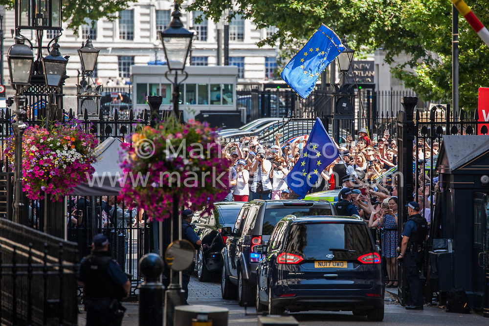 London, UK. 24 July, 2019. Theresa May, accompanied by her husband Philip, leaves Downing Street to proceed to Buckingham Palace to tender her resignation to the Queen.