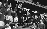 GAA All Ireland Minor Football Final Cork v. Loais 24th September 1967 Croke Park.<br /><br />His Grace Most Rev. Dr. Morris Archbishop of Cashel (centre) presenting the cup to Cork Captain D. Aherne with some of the victorious Cork Team Cherring *** Local Caption *** It is important to note that under the COPYRIGHT AND RELATED RIGHTS ACT 2000 the copyright of these photographs are the property of the photographer and they cannot be copied, scanned, reproduced or electronically stored in any form whatsoever without the written permission of the photographer