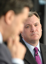 © Licensed to London News Pictures. 27/11/2012. Stevenage, UK ED BALLS (right), watches ED MILIBAND talk. Ed Miliband MP, Leader of the Labour Party and Ed Balls MP, Labours Shadow Chancellor hold a joint question and answer session at Propak Sheet Metal LTD in Stevenage, today 27th November 2012, ahead of the Autumn Statement. Photo credit : Stephen Simpson/LNP