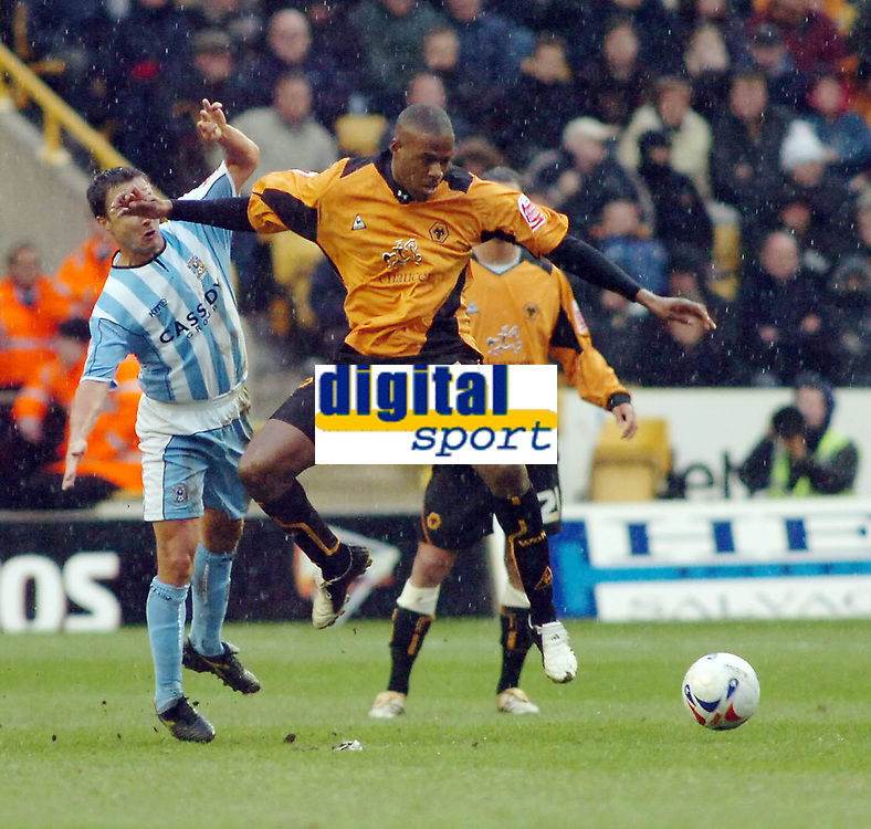 Photo: Kevin Poolman.<br />Wolverhampton Wanderers v Coventry City. Coca Cola Championship. 08/04/2006. Wolves' Carl Cort gets to the ball first ahead of Dennis Wise.