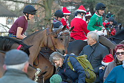 © Licensed to London News Pictures. 24/12/2015. Blackheath, London.  The King's Troop Royal Horse Artillery have taken part in their now traditional Christmas eve trot from their barracks in Woolwich to Morden College in Blackheath. The Troop, based in Woolwich since 2012, were dressed in Christmas outfits with tinsel and were met by the residents of Morden College Almshouses with mulled wine, mince pies and brandy. Credit : Rob Powell/LNP