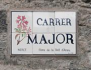 Ceramic street sign, Esterri d'Aneu, Pyrenees mountains, Catalonia, Spain.