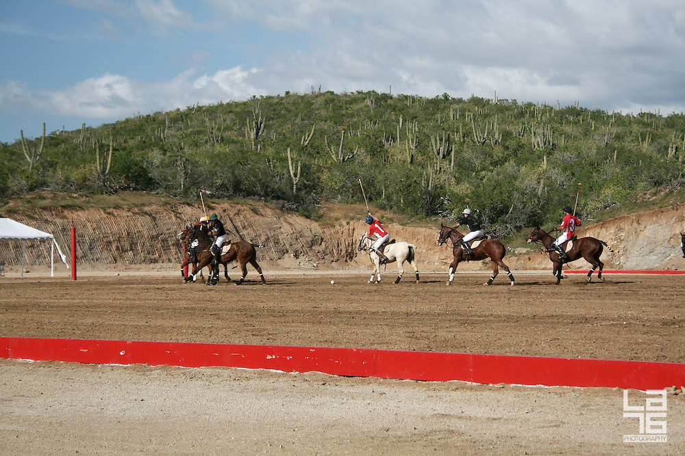 Polo Tournament organized by Club Polo Cabo, Los Cabos, Mexico. Photos show the final match between the teams Baja California Sur and Baja California Norte. Winners of this polo tournament were the team in red shirts from Baja California Norte. At the end of the game, Baja California Sur team donated 2,000 USD to charity organization Casa Hogar, for local children in need. <br /> <br /> Club Polo Cabo is in its first stages of construction in Baja California's stylish Los Cabos peninsula less than two hours flight from the US south west border. This luxurious Polo country club will offer polo players and enthusiasts a complete experience from the sport to the lifestyle.<br /> <br /> Polo is arguably one of the most exciting of games in the world. The King of Games is still the game of kings. Today, polo is played around the globe, and is a national sport in many countries and growing rapidly.