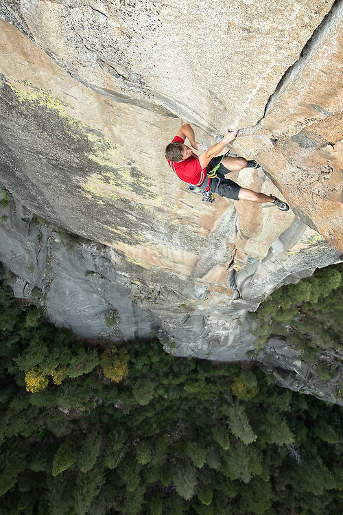 Tommy Caldwell climbing the Alien Roof Finish (12b) on the North Face of the Rostrum in Yosemite National Park.