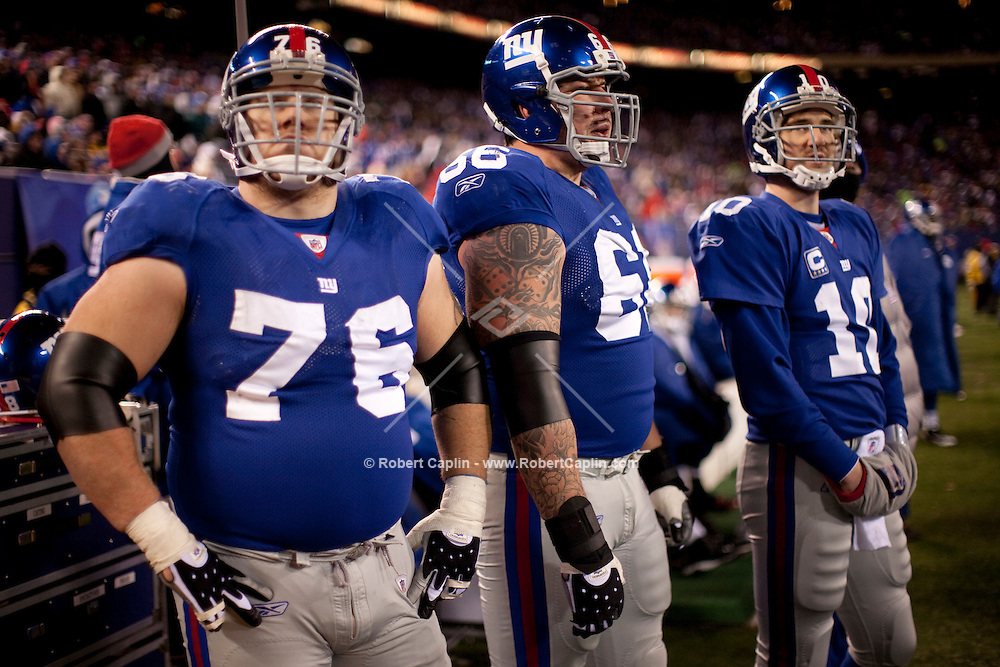 Chris Snee, 76, David Diehl, 66, and Eli Manning, 10, on the sidelines during the NY Giants vs Carolina Panthers matchup at Giants Stadium in East Rutherford, NJ on Friday, Dec. 26, 2008.