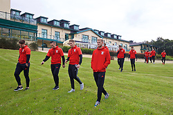 CARDIFF, WALES - Friday, October 7, 2016: Wales' Tom Bradshaw, Andrew Crofts, David Edwards and goalkeeper Adam Davies during a team walk at the Vale Resort ahead of the 2018 FIFA World Cup Qualifying Group D match against Georgia. (Pic by David Rawcliffe/Propaganda)