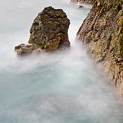 Long exposure of waves against the rocks on the headland at Zihuatanejo, Mexico