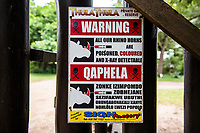 signage warning that rhino horns have been infused with posioned, Thula Thula Game Reserve, KwaZulu Natal, South Africa