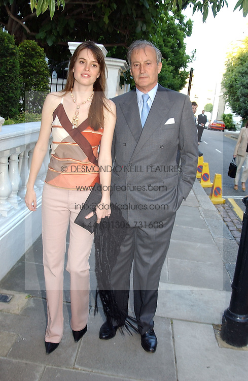 LORD ROMSEY and his daughter the HON.ALEXANDRA KNATCHBULL at Sir David & Lady Carina Frost's annual summer party held in Carlyle Square, London on 6th July 2004.