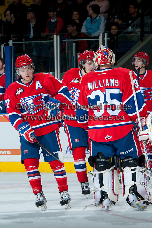 KELOWNA, CANADA -JANUARY 29: Mitch Holmberg RW #17 of the Spokane Chiefs celebrates a goal with teammate Eric Williams #35 on January 29, 2014 at Prospera Place in Kelowna, British Columbia, Canada.   (Photo by Marissa Baecker/Getty Images)  *** Local Caption *** Mitch Holmberg; Eric Williams;