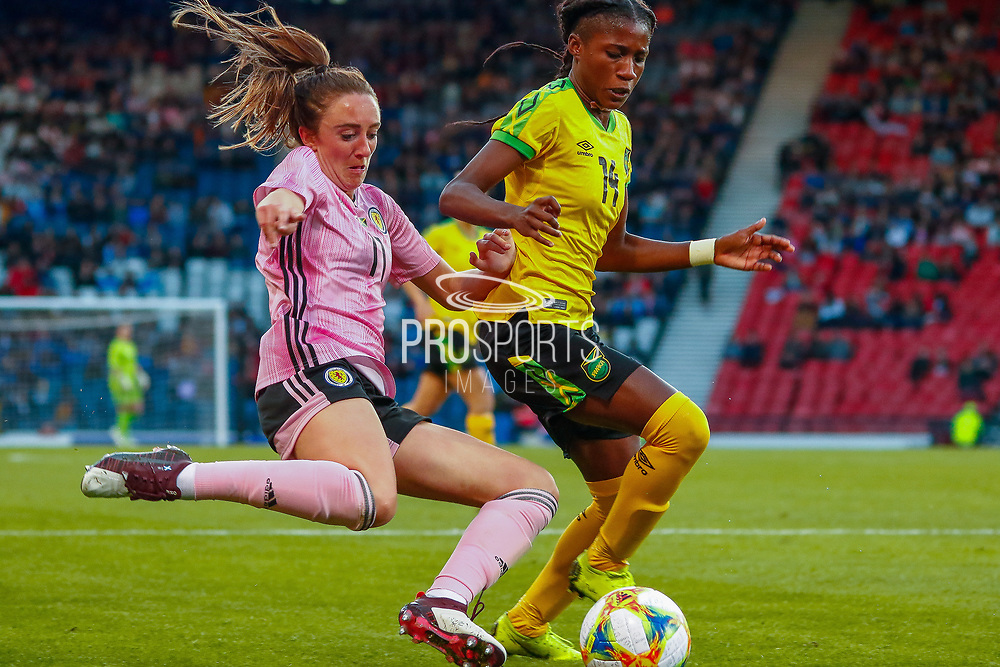 Scotlands Lisa EVANS (Arsenal WFC (ENG)) & Deniesha BLACKWOOD (Univ. West Florida (USA)) of Jamaica challenge for the ball during the International Friendly match between Scotland Women and Jamaica Women at Hampden Park, Glasgow, United Kingdom on 28 May 2019.