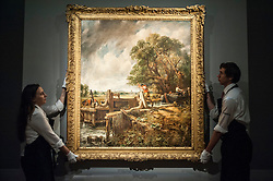 """© Licensed to London News Pictures. 04/12/2015. London, UK. Technicians present """"The Lock"""" by John Constable (est. £8-12 million), ahead of Sotheby's London evening sale of Old Master and British paintings on 9th December 2015. This is the first time that this painting has been on the market for 160 years.  Photo credit : Stephen Chung/LNP"""