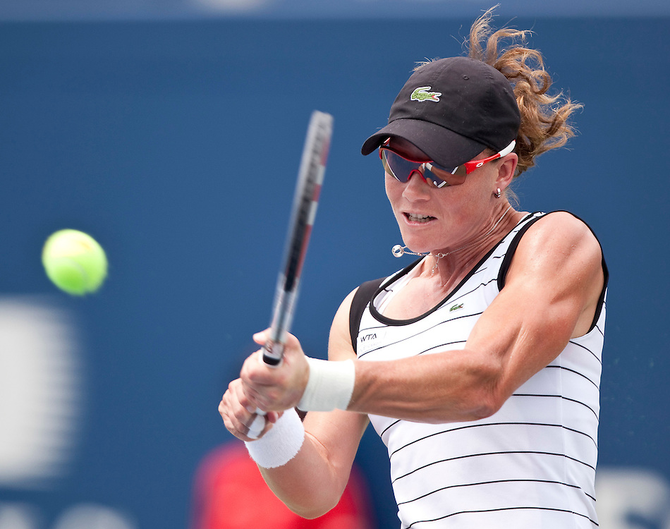 Samantha Stosur of Australia returns a shot during her straight sets loss to  Serena Williams of the United States in the final at the Rogers Cup WTA event in Toronto, Ontario, August 14, 2011.<br /> AFP PHOTO/Geoff Robins