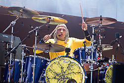 © Licensed to London News Pictures . FILE PICTURE DATED 30/06/2012 . Manchester, UK. The Stone Roses are to headline at the 2013 Isle of Wight Festival organisers have announced today (26th November 2012). Pictured: The Stone Roses' drummer Reni ( Alan Wren ), performs with The Stone Roses at Heaton Park in Manchester , for their Second Coming event in June 2012 . Photo credit : Joel Goodman/LNP