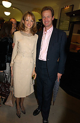 JULIAN and CAROLINE CHAMBERLEN at a party to celebrate the 10th anniversary of the Smythson Fashion Diary and to the launch of the 2007 Limited Edition held at Smythson, New Bond Street, London on 25th October 2006.<br />