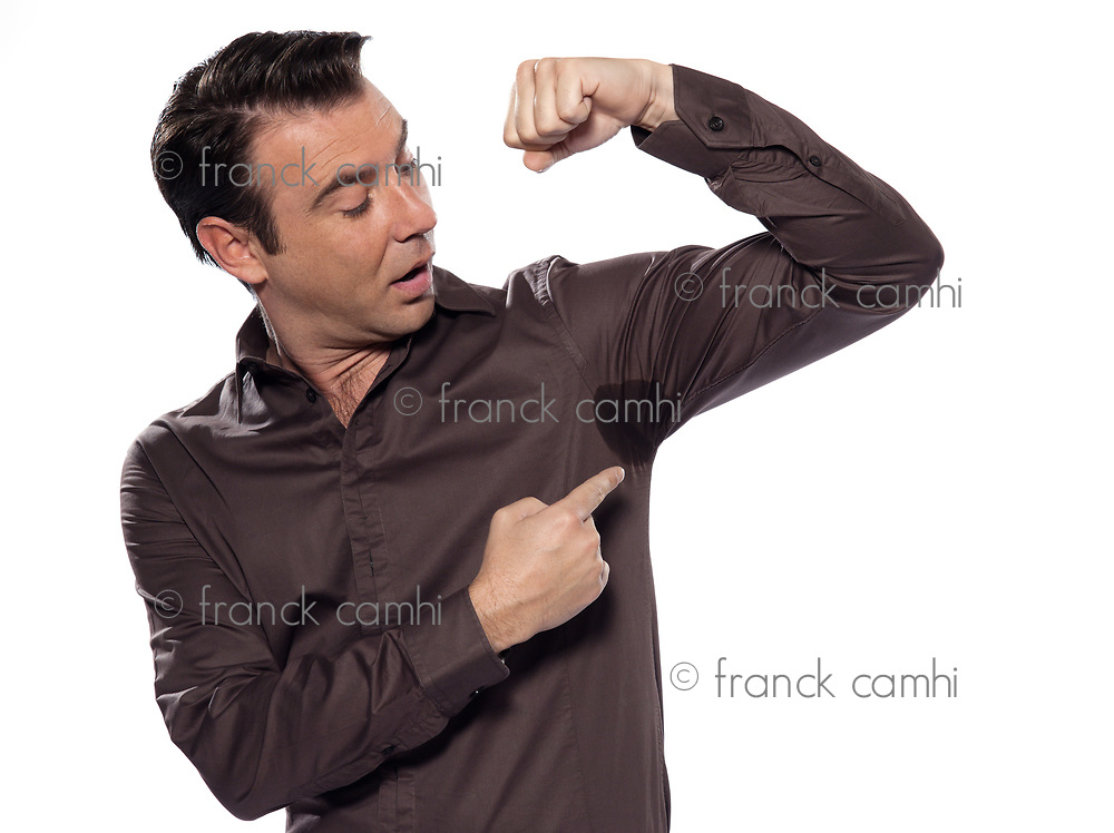 one caucasian man looking at sweat stain  sweating perspiring stain surprised isolated studio on white background