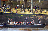 WASHINGTON CROSSING, PA - DECEMBER 7:  Re-enactors row a boat during a dress rehearsal for the crossing of the Delaware River at Washington Crossing State Park December 7, 2014 in Washington Crossing, Pennsylvania.  The dress rehearsal is held annually, about two weeks before the Christmas Day reenactment. (Photo by William Thomas Cain/Cain Images)