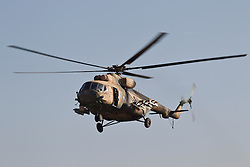 © Licensed to London News Pictures. 11/12/2014. Fishkhabour, Iraq. 11/12/2014. Fishkhabour, Iraq. An Iraqi Air Force Mi-17 Hip helicopter comes in to land at an Iraqi-Kurdish peshmerga base in Fishkhabour before a mission to supply Yazidi refugees on Mount Sinjar.<br /> <br /> Although a well publicised exodus of Yazidi refugees took place from Mount Sinjar in August 2014 many still remain on top of the 75 km long ridge-line, with estimates varying from 2000-8000 people, after a corridor kept open by Syrian-Kurdish YPG fighters collapsed during an Islamic State offensive. The mountain is now surrounded on all sides with winter closing in, the only chance of escape or supply being by Iraqi Air Force helicopters. Photo credit: Matt Cetti-Roberts/LNP