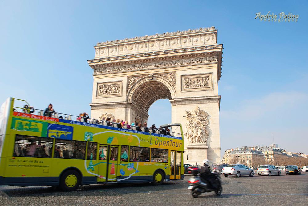 Tour bus entering traffic circle