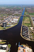 Nederland, Groningen, Gemeente Groningen, 01-05-2013; Oosterhogebrug, met woonschepenhaven en woontorenTasmantoren. Knooppunt van waterwegen: begin van Van Starkenborghkanaal met Oostersluis (li), Eemskanaal.<br /> View on the city of Groningen and surroundings, residential tower Tasmantoren , Eemskanaal crossing Van Starckenborghkanaal (channels) and business park.<br /> luchtfoto (toeslag op standard tarieven)<br /> aerial photo (additional fee required)<br /> copyright foto/photo Siebe Swart