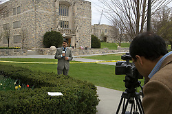 Blacksburg, Va. UNITED STATES: Indian journalists from New Delhi's Aaj Tak television station give a report in front of Norris Hall, the site of the grisly massacre at Virginia Tech University in Blacksburg, Virginia. A 23-year-old student from South Korea was identifiedas the gunman who carried out the deadliest school shooting in US history.  33 people died on Monday, police named the gunman as Cho Seung-Hui, a student at the school and resident alien in the United States. (AMi Vitale)