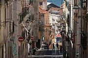 The steep perspective of Rua de Bica de Duarte Belo (Elevador da Bica) in Bairro Alto, Lisbon, Portugal.