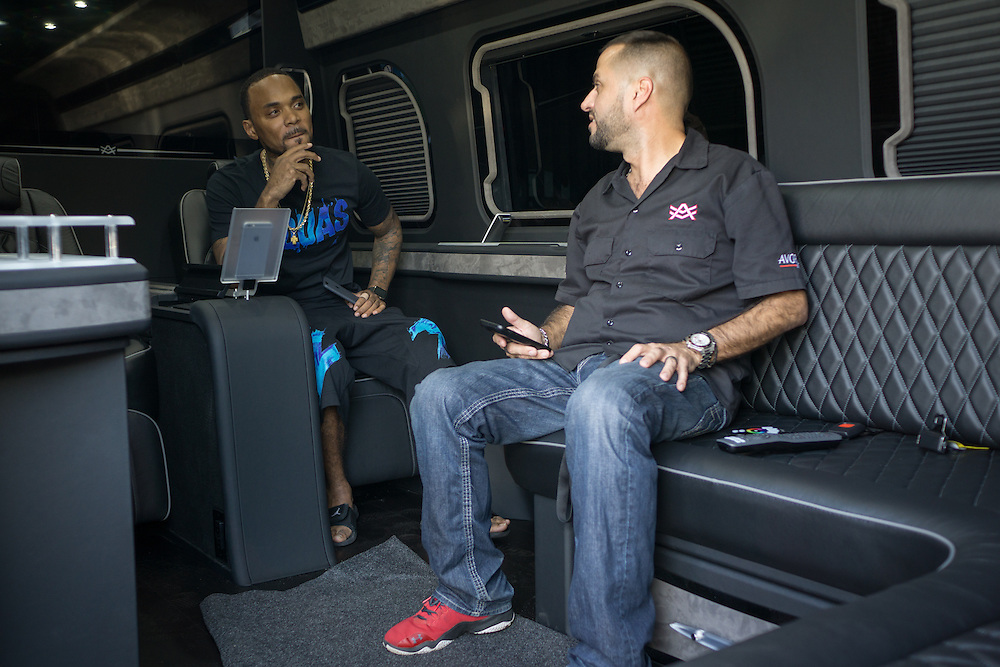 DORAL, FLORIDA, DECEMBER 11, 2015<br /> Alex Vega, right, owner of The Auto Firm, a South Florida car customizing and restoring shop which has a vast clientele of professional athletes and entertainers,  shows Atlanta rapper Peeto the Plug a customized Mercedes Benz limo van. The van sells for $175.000.<br /> (Photo by Angel Valentin/Freelance)