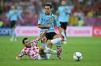 FUSSBALL  EUROPAMEISTERSCHAFT 2012   VORRUNDE Kroatien - Spanien                 18.06.2012 Danijel Pranjic  (Kroatien) am Boden gegen Xavi Hernandez (Spanien)