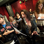 """December 5, 2013 - New York, NY: Members of the NBC musical drama television series """"Smash"""" including, from left, Jeremy Jordan, Julia Mattison, Molly Hager, Carrie Manolakos, Shannon Ford (drums), Monet Julia Sabel, and Dennis Michael Keefe (bass), rehearse at Smash Studios at 36th Street in Manhattan on Thursday afternoon in preparation for their cabaret performance of """"HIT LIST,"""" which will premiere Sun, Dec 8 at 54 Below. CREDIT: Karsten Moran for The New York Times"""
