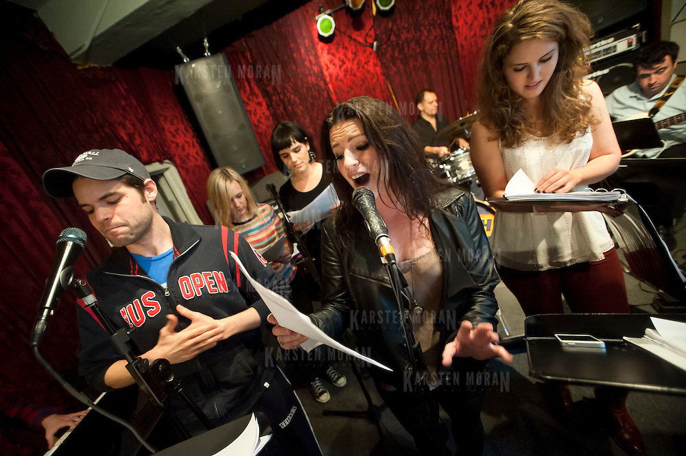 "December 5, 2013 - New York, NY: Members of the NBC musical drama television series ""Smash"" including, from left, Jeremy Jordan, Julia Mattison, Molly Hager, Carrie Manolakos, Shannon Ford (drums), Monet Julia Sabel, and Dennis Michael Keefe (bass), rehearse at Smash Studios at 36th Street in Manhattan on Thursday afternoon in preparation for their cabaret performance of ""HIT LIST,"" which will premiere Sun, Dec 8 at 54 Below. CREDIT: Karsten Moran for The New York Times"