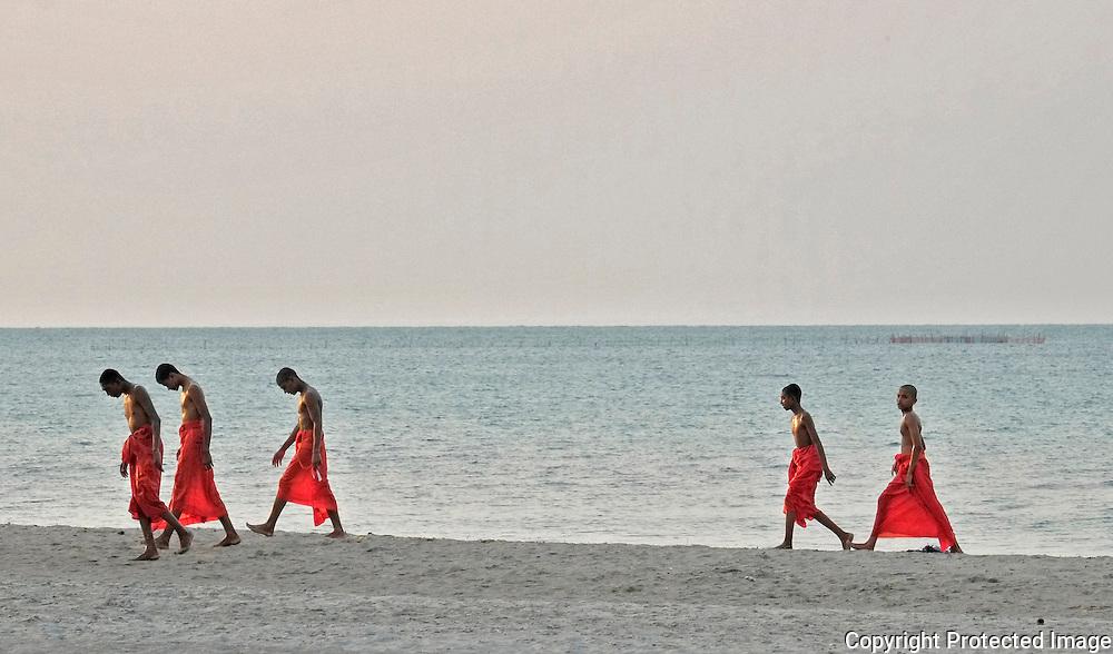 Buddhist monks after a swim in Jaffna, Sri Lanka.