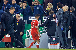 DUBLIN, REPUBLIC OF IRELAND - Friday, March 24, 2017: Wales' Neil Taylor walks down the tunnel after being shown a red card and sent off against Republic of Ireland during the 2018 FIFA World Cup Qualifying Group D match at the Aviva Stadium. (Pic by David Rawcliffe/Propaganda)