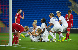CARDIFF, WALES - Tuesday, August 21, 2014: England's Laura Bassett celebrates scoring the third goal against Wales during the FIFA Women's World Cup Canada 2015 Qualifying Group 6 match at the Cardiff City Stadium. (Pic by Ian Cook/Propaganda)
