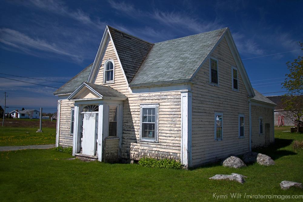 North America, Canada, Guysborough. Yellow House, green grass. blue sky.