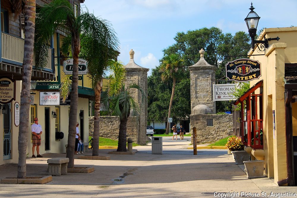 A late afternoon view of St. George Street looking toward the City Gates in downtown  St. Augustine, Florida. St. George Street was the main thoroughfare through the colonial city and is still considered the heart of St. Augustine. Here you will find some of the historical attractions, restaurants, galleries and shopping that St. Augustine is known for. St. Augustine is the oldest continually occupied European city in the United States.