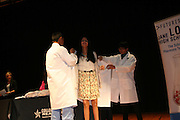 Pharmacy technology high school students receive their white coats and scrubs at a White Coat Ceremony Jan. 14, 2015 for the Futures Academy at Jane Long.