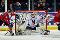 KELOWNA, BC - MARCH 09:  Leif Mattson #28 of the Kelowna Rockets looks for the pass as Dylan Garand #30 of the Kamloops Blazers defends the net at Prospera Place on March 9, 2019 in Kelowna, Canada. (Photo by Marissa Baecker/Getty Images)
