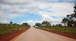 A car on the road between Derby and Broome in the wet season.
