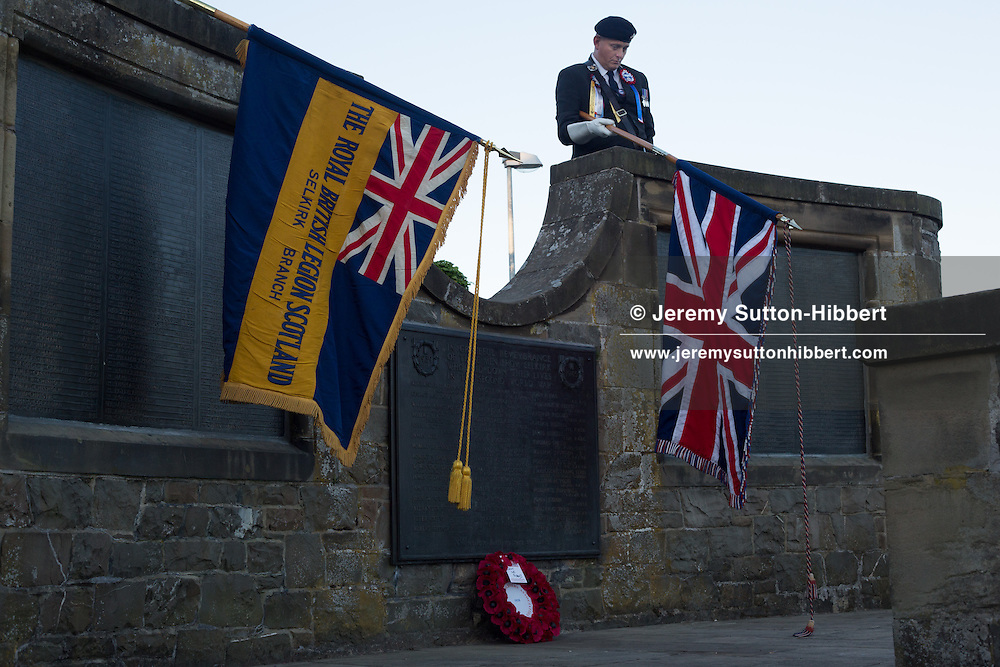 Ex-servicemen, and British Legion members, laying a wreath at the Selkirk War Memorial, for the Common Riding festivities in Selkirk, with Royal Burgh Standard Bearer Martin Rodgerson, in Selkirk, Scotland, Friday 14th June 2013.