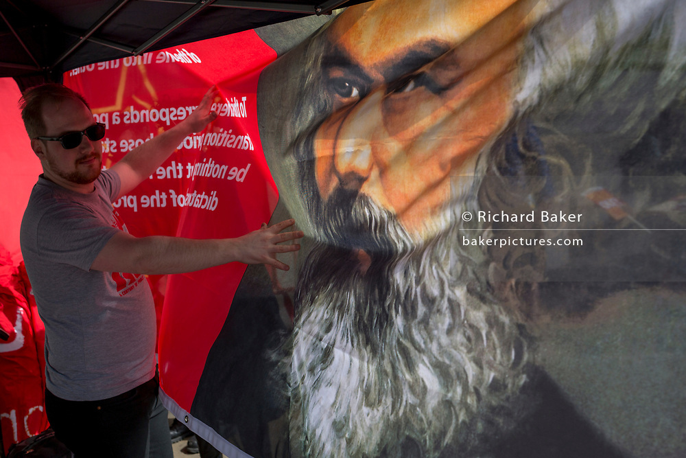 Members of the Communist Party of Great Britain in Trafalgar Square with the face of Karl Marx on a banner during the traditional May Day celebrations in the capital, on 1st May 2018, in London, England.