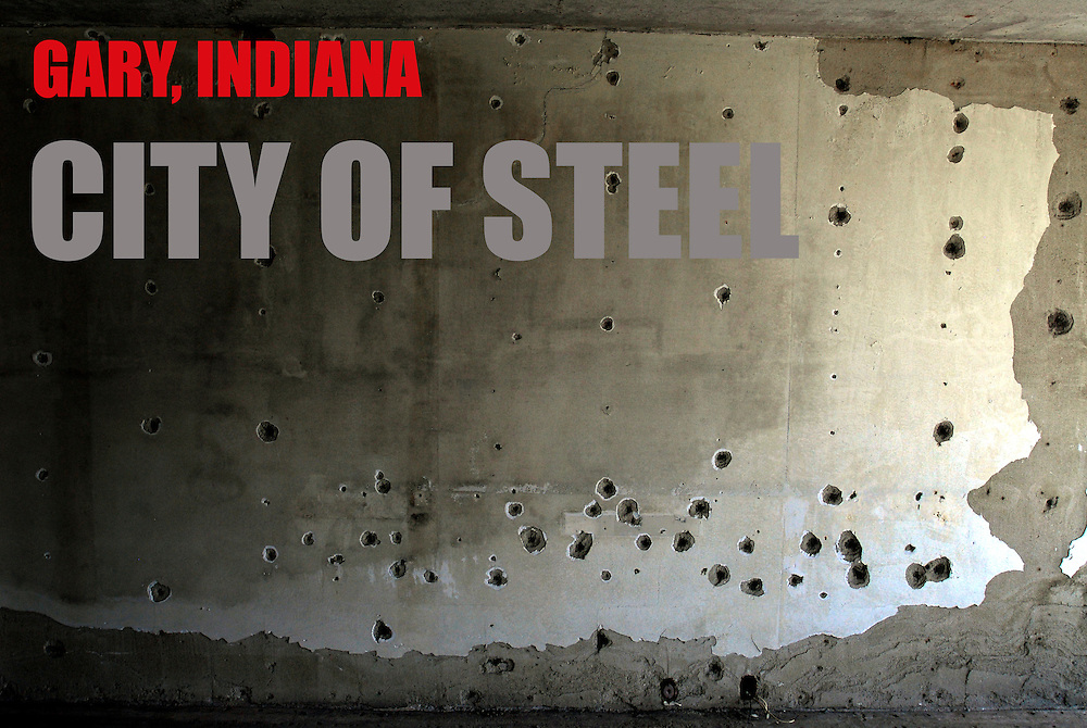 """Bullet holes mark a wall in Gary, Indiana. The city of 100,000 was founded in 1906 by the U.S. Steel Corporation as the home for its new plant. but in the 1960s Gary's fortunes took a downturn. Businesses closed and the crime rate spiraled earning Gary the infamous distinction of """"Murder Capital of America."""" African Americans, which make up 85% of Gary's population face high rates of joblessness with the unemployment rate for black males at 18%."""