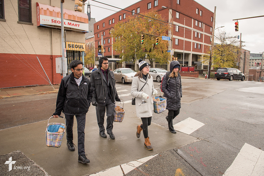 Student volunteers (L-R) Deepak Gopalakrishnan, Brandon Price, Emma Victorelli, and Kristi Nowak from First Trinity Evangelical–Lutheran Church deliver sandwiches to the homeless on Sunday, Nov. 20, 2016, in Pittsburgh. LCMS Communications/Erik M. Lunsford