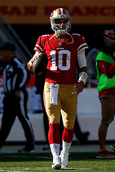 SANTA CLARA, CA - DECEMBER 17: Quarterback Jimmy Garoppolo #10 of the San Francisco 49ers warms up before the game against the Tennessee Titans at Levi's Stadium on December 17, 2017 in Santa Clara, California.  (Photo by Jason O. Watson/Getty Images) *** Local Caption *** Jimmy Garoppolo