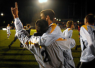 19 NOV. 2020 -- FENTON, Mo. -- St. John Vianney High School soccer players Richard Dorhauer (2) and Jason Hackett (16) celebrate as their teammates rush the field after the Griffins beat St. Louis University High School 2-0 during the MSHSA Class 3 state soccer semifinal at the A-B Center in Fenton, Mo. Friday, Nov. 19, 2010. Vianney advances to the Class 3 title game Saturday night. Image © copyright 2010 Sid Hastings.